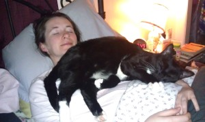 This is me and my sweet boy cat. I'm not actually sleeping since the light is on (and I'm propped up on an additional pillow) but T thought it would make for a better picture... but I do often sleep with the cat like that - he puts himself there and I just enjoy it